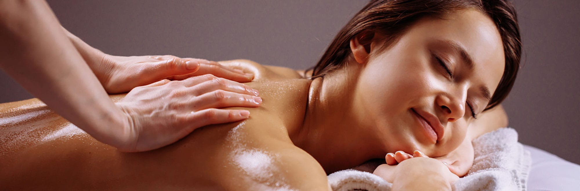 Woman Getting Back Massage - Massage Oil
