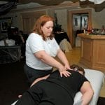 Woman Getting Back Massage by Therapist